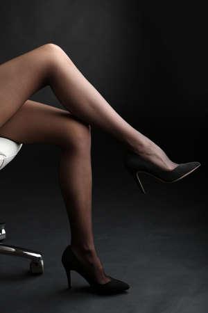 nylons: Stockings on perfect woman legs on dark background Stock Photo