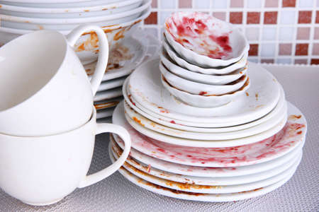 dirtiness: Dirty dishes on bright background