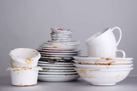 dirty dishes: Dirty dishes on gray background Stock Photo