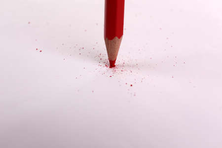 Breaking pencil on paper, close up photo