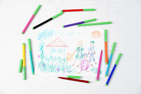 Kids Drawing Of Family And Colored Pencils On Wooden Table Stock Photo    27543534