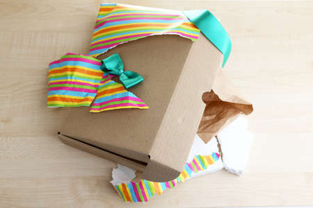 unwrapped: Unwrapped and opened gift box  on wooden background Stock Photo