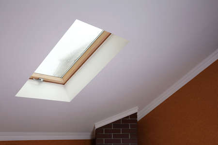 Roof skylight in new modern attic room  photo