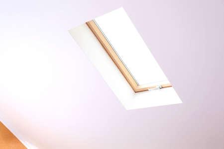 Roof skylight in new modern attic room  photo