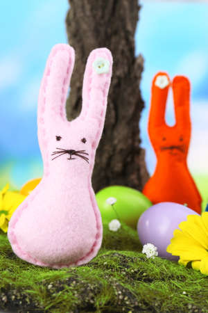 Funny handmade Easter rabbits on nature background photo