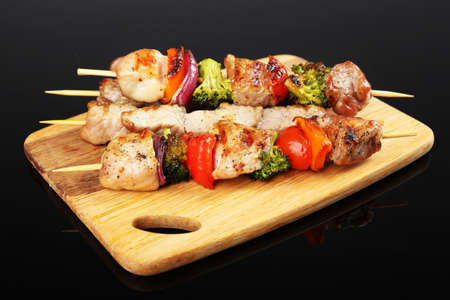 Pork kebab on black background photo