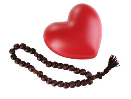 sacrosanct: Heart with rosary beads isolated on white