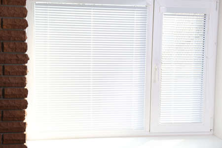 blinds: White window with blinds