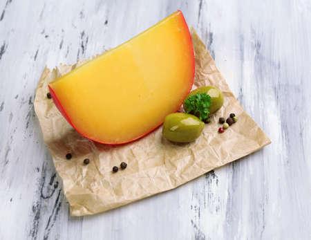 chees: Tasty Italian cheese on wooden table