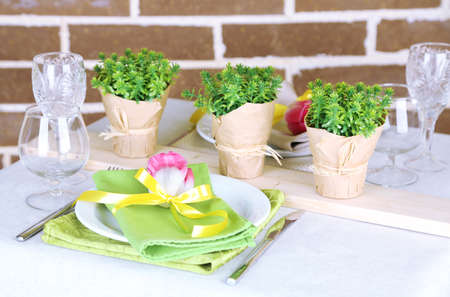 Beautiful spring table setting on bright background photo