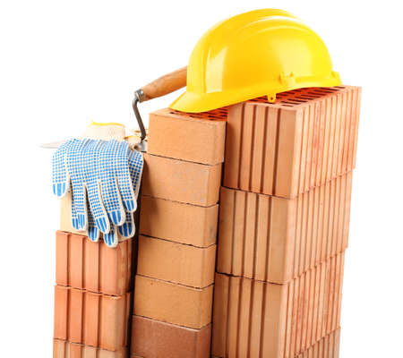 New bricks and building tools, isolated on white  photo