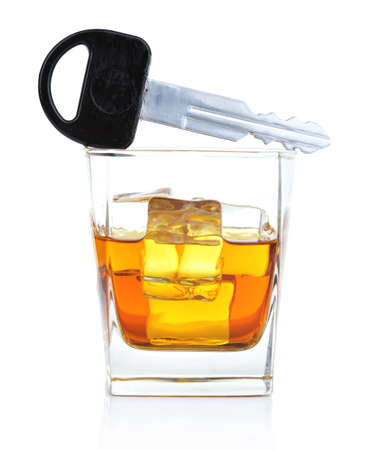 Composition with car key and glass of whiskey, isolated on white photo