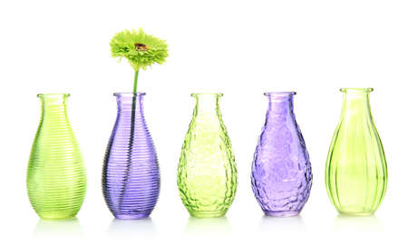 Different decorative vases isolated on white photo