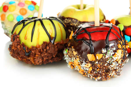 Candied apples on sticks close up photo