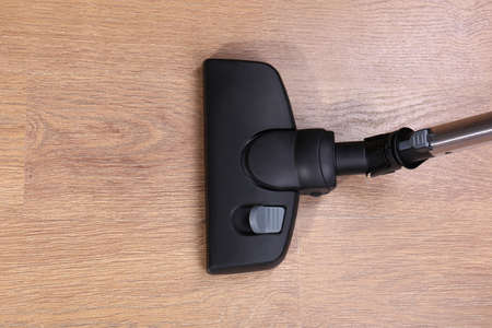 Vacuuming floor in house photo