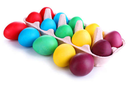 Colorful Easter eggs in tray isolated on white photo