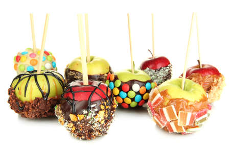 Candied apple on stick isolated on white photo