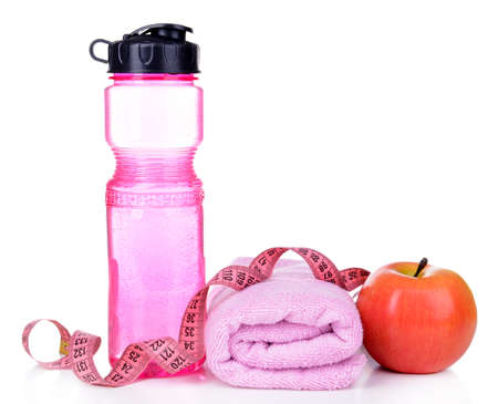 Sports bottle, apple,towel and measuring tape isolated on white photo