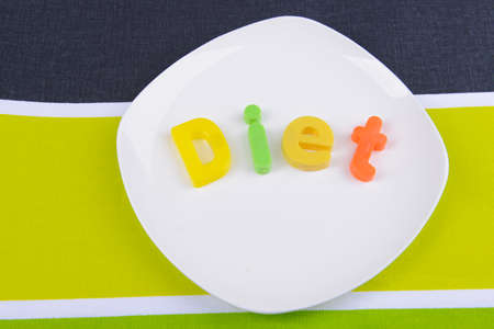 microelements: Plate with diet inscription on table close-up Stock Photo
