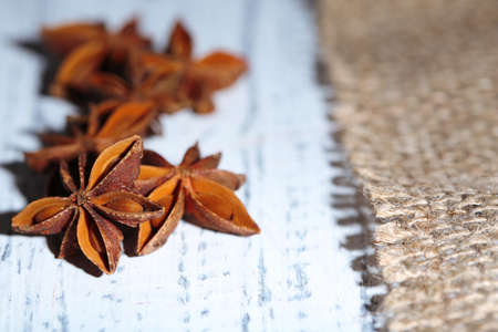 brownish: Star anise on wooden background