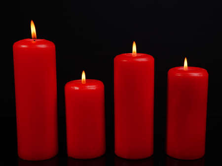 Beautiful candles isolated on black photo