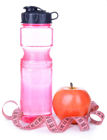 Sports bottle, apple and measuring tape isolated on white photo