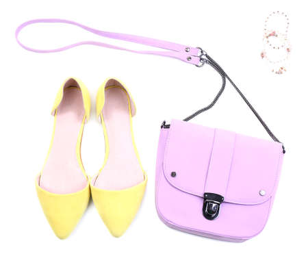 clasp feet: Pink women bag and color shoes, isolated on whit