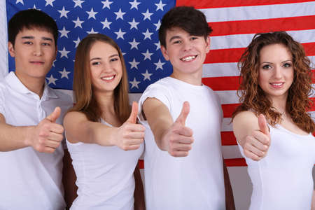 Group of beautiful young people on of American flag photo