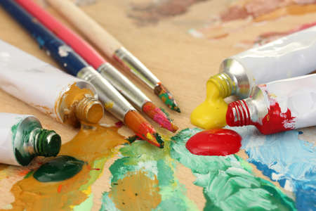 Abstract acrylic paint, paint tubes and brushes on wooden  palette Stock Photo - 28166442