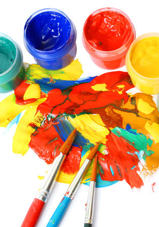 Abstract gouache paint and brushes, isolated on white photo