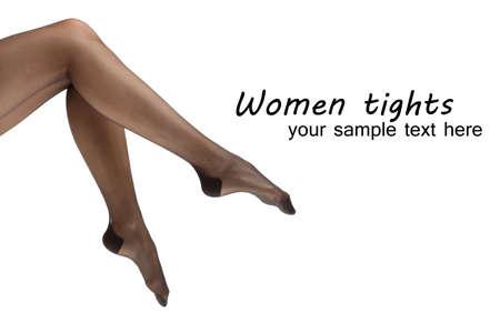 白で隔離され、完璧な女性の足のストッキング