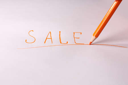 Word Sale and pencil on paper, isolated on white photo