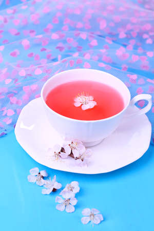 stimulated: Fragrant tea with flowers on wooden table close-up