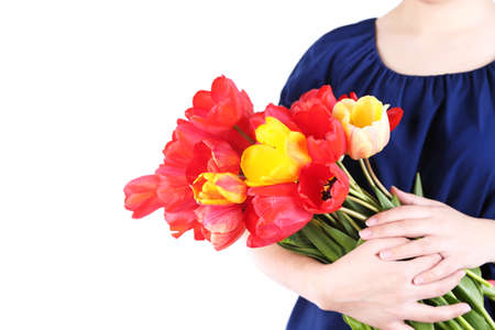 Colorful tulips in female hands isolated on white photo