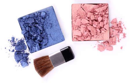 Crushed eyeshadow with brush isolated on white  Stock Photo - 28223458