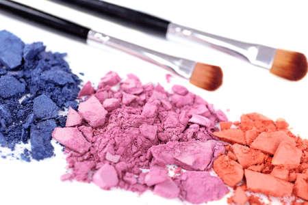 Crushed eyeshadow with brushes isolated on white  Stock Photo - 28223462