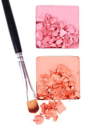 Crushed eyeshadow with brush isolated on white  Stock Photo - 28223054