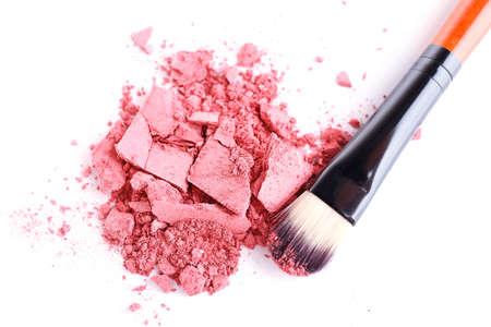 Crushed eyeshadow with brush isolated on white  Stock Photo