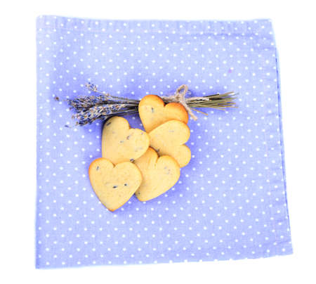 Lavender cookies on color napkin, isolated on white photo