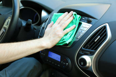 valet: Hand with microfiber cloth polishing car Stock Photo