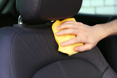 Hand with microfiber cloth polishing car photo