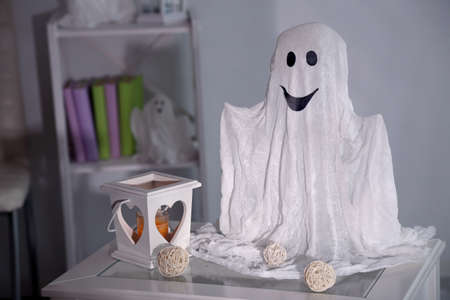 Halloween ghost, on home interior background photo
