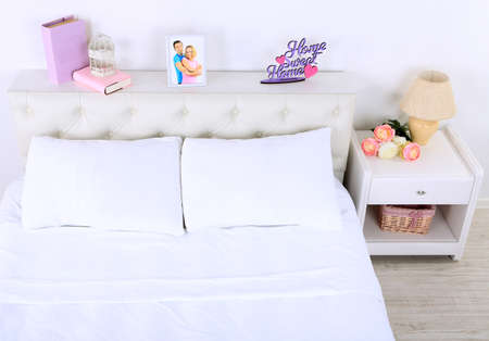 Comfortable soft bed in room photo