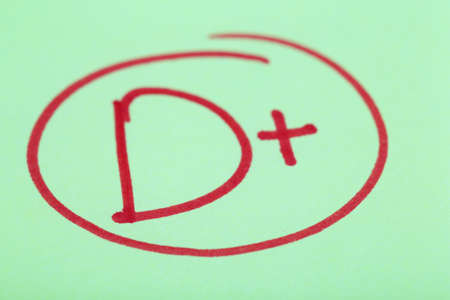 Grade D+ written on an exam paper Stock Photo - 28339841