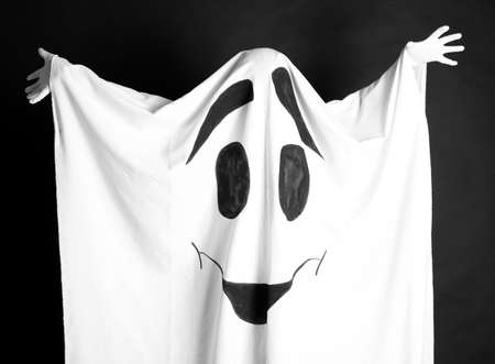 Halloween ghost, on dark background photo