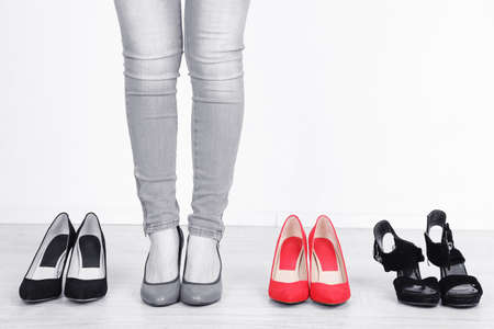 Concept of individuality.One bright color shoes among grey shoes photo