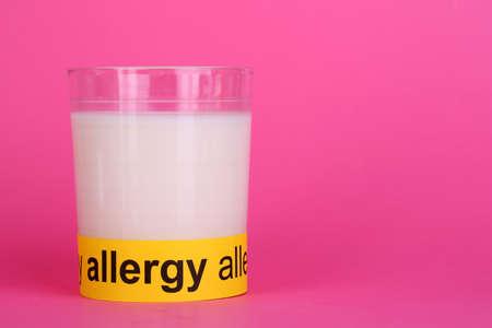 Milk allergy on pink background photo