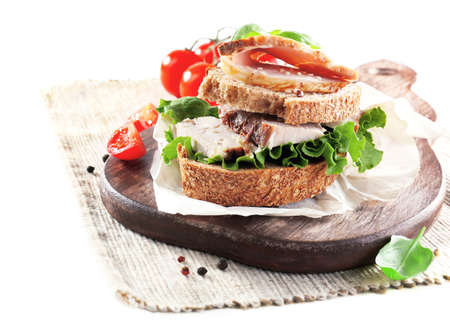 Delicious sandwiches with meet on table close-up photo