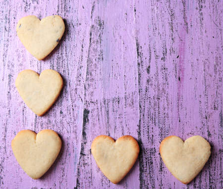 Lavender cookies on color wooden background photo