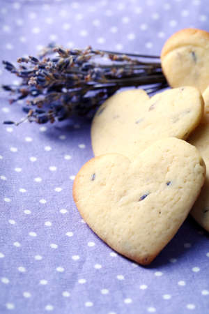 Lavender cookies on color napkin background photo